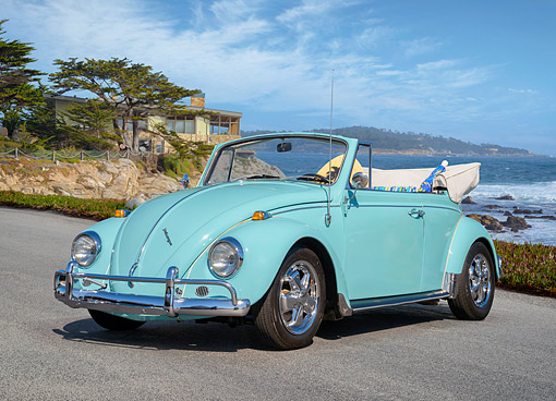 AUT 21 RK3777 01 © Kimball Stock 1955 Volkswagen Beetle Convertible Turquoise 3/4 Front View On Pavement By Ocean