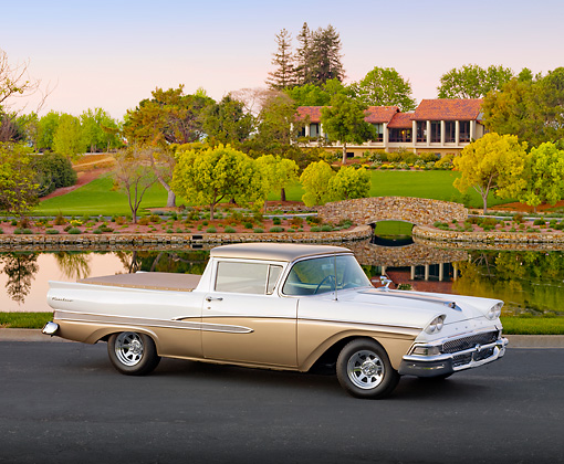 AUT 21 BK0013 01 © Kimball Stock 1958 Ford Ranchero White And Bronze 3/4 Front View On Pavement By Pond