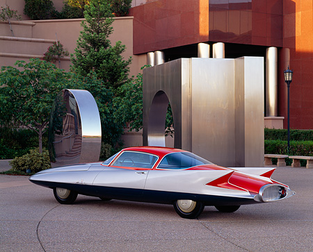 AUT 21 RK0040 03 © Kimball Stock 1956 Silver Ghia Gilda Prototype 3/4 Rear View By Sculpture Trees