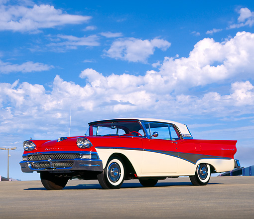 AUT 21 RK0065 05 © Kimball Stock 1958 Ford Fairlane 500 Skyliner Retractable Red & White Lower 3/4 Front On Pavement