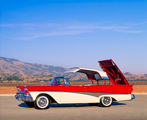 AUT 21 RK0070 02 © Kimball Stock 1958 Ford Fairlane 500 Skyliner Retractable Red & White 3/4 Front View Top And Trunk Open