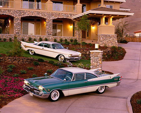 AUT 21 RK0097 06 © Kimball Stock 1959 DeSoto White & Green, Dodge Lancer White 3/4 Side View On Driveway At Night
