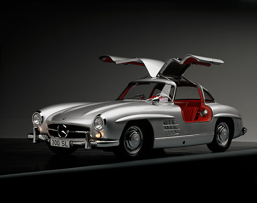AUT 21 RK0117 06 © Kimball Stock 1956 Mercedes-Benz 300SL Gullwing Silver Doors Up Front 3/4 View On Gray Line Studio