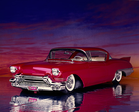 AUT 21 RK0147 03 © Kimball Stock 1957 Candy Raspberry Cadillac Eldorado Kustom 3/4 Front View On Glossy Floor Sunset Background
