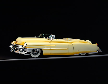 AUT 21 RK0150 09 © Kimball Stock 1953 Cadillac Eldorado Convertible Yellow 3/4 Side On Gray Line Headlights On Studio Background