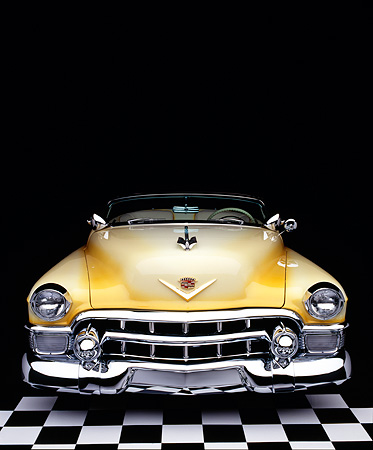 AUT 21 RK0154 12 © Kimball Stock 1953 Yellow Cadillac Eldorado Convertible Top Down Head On Shot On Checkerboard Studio Background