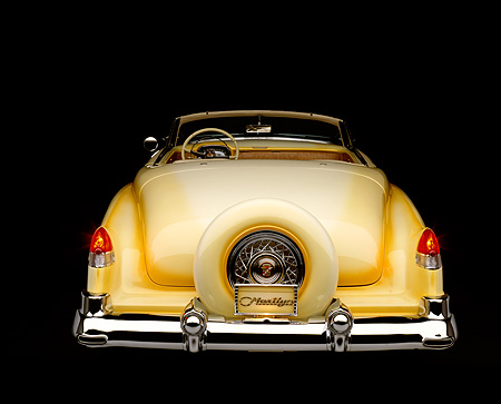 AUT 21 RK0155 05 © Kimball Stock 1953 Cadillac Eldorado Convertible Yellow Top Down Rear View Brake Lights On Showing