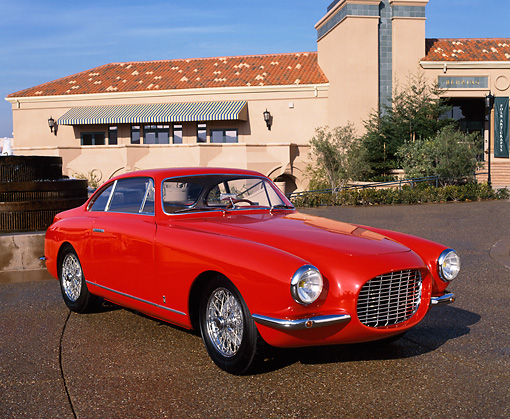 AUT 21 RK0160 08 © Kimball Stock 1954 Fiat Vignale 8V Coupe Red 3/4 Front View On Pavement