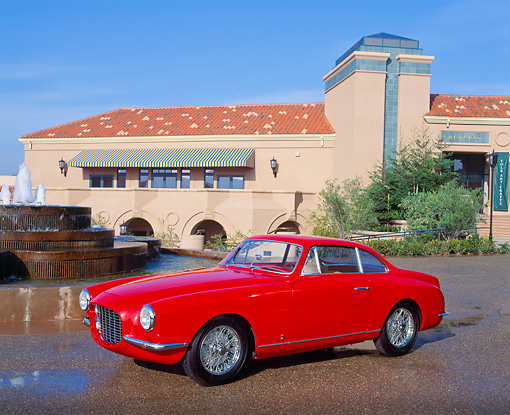 AUT 21 RK0161 08 © Kimball Stock 1954 Red Fiat Vignale Coupe V8 3/4 Side View By Water Fountain And Building