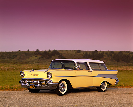 AUT 21 RK0163 02 © Kimball Stock 1957 Chevy Nomad Wagon Yellow 3/4 Side View On Pavement