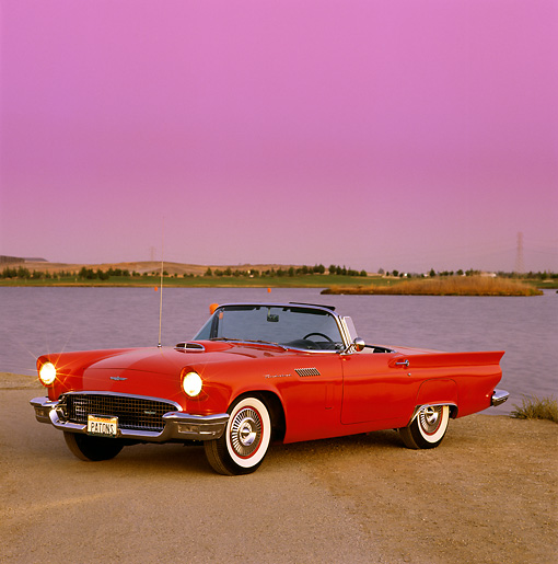AUT 21 RK0191 02 © Kimball Stock 1957 Ford Thunderbird Convertible Red 3/4 Side On Pavement By Lake