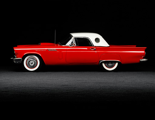 AUT 21 RK0214 04 © Kimball Stock 1957 Ford Thunderbird Red Convertible Profile View On Gray Sand Studio Background