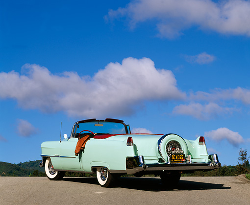 AUT 21 RK0235 04 © Kimball Stock 1954 Light Green Cadillac Convertible 3/4 Rear View On Pavement Blue Sky Clouds
