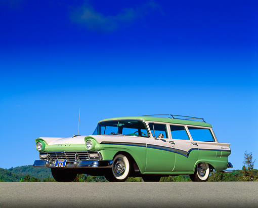 AUT 21 RK0237 04 © Kimball Stock 1957 Ford Station Wagon Green And White Low 3/4 Side View On Pavement