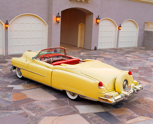 AUT 21 RK0245 04 © Kimball Stock 1953 Yellow Eldorado Cadillac Convertible 3/4 Rear By Garages