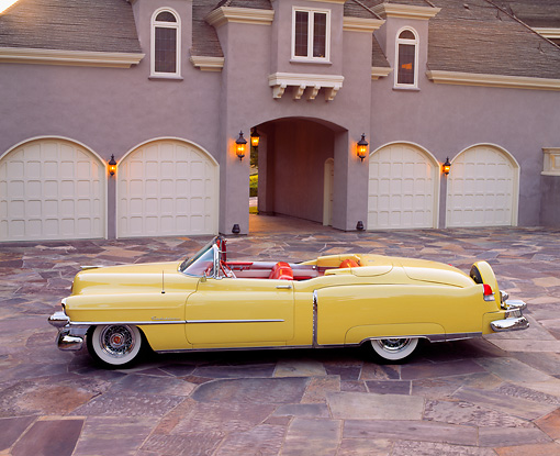 AUT 21 RK0250 04 © Kimball Stock 1953 Cadillac Eldorado Convertible Yellow Profile View On Driveway