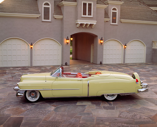 AUT 21 RK0250 05 © Kimball Stock 1953 Cadillac Eldorado Convertible Yellow Profile View On Driveway