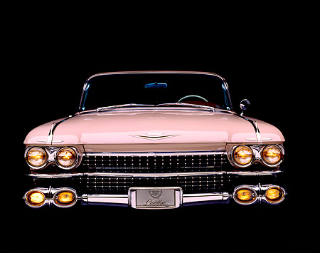 AUT 21 RK0260 04 © Kimball Stock 1959 Pink Cadillac DeVille Head On View Headlights On Studio Background