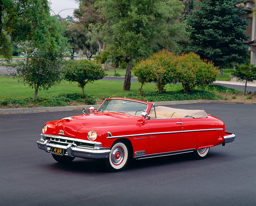AUT 21 RK0283 04 © Kimball Stock 1951 Red Lincoln Convertible Cosmopolitan 3/4 Side View On Pavement By Trees And Grass