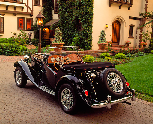 AUT 21 RK0288 04 © Kimball Stock 1952 MG TD Convertible Black 3/4 Rear View On Driveway