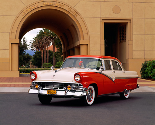 AUT 21 RK0332 07 © Kimball Stock 1956 Ford Fairlane Town Sedan Red And White 3/4 Side On Pavement