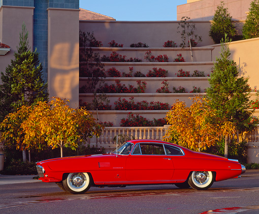 AUT 21 RK0343 01 © Kimball Stock 1954 Red Desoto Coupe Adventurer II Side View On Pavement In Front Of Building