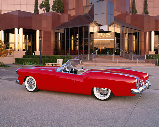 AUT 21 RK0350 04 © Kimball Stock 1953 Red Plymouth Belmont Convertible 3/4 Rear View On Pavement In Front Of Museum