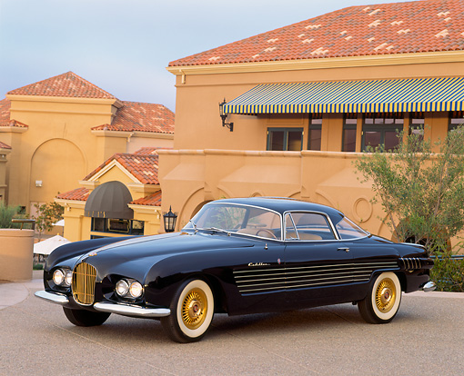 AUT 21 RK0355 03 © Kimball Stock 1953 Black Cadillac Ghia Coupe 3/4 Front View In Front Of Building At Dusk