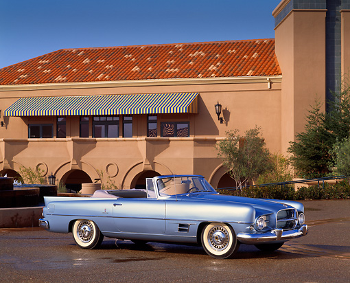 AUT 21 RK0381 02 © Kimball Stock 1957 Dual Ghia Convertible Blue 3/4 Front View On Pavement