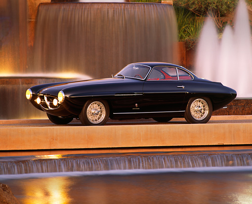AUT 21 RK0387 01 © Kimball Stock 1953 Fiat Ghia 8V Supersonic Coupe Black 3/4 Front View By Fountain Headlights On