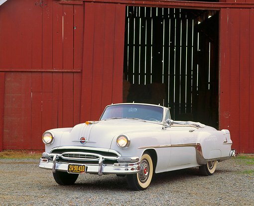 AUT 21 RK0402 05 © Kimball Stock 1954 White Pontiac Star Chief Convertible 3/4 Front View By Red Barn Headlights On