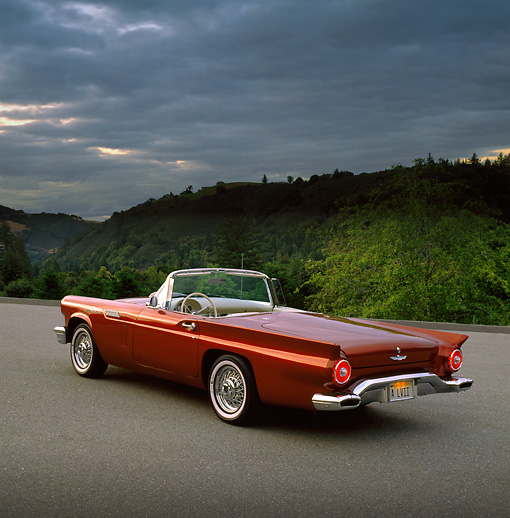 AUT 21 RK0441 02 © Kimball Stock 1957 Ford Thunderbird Convertible Cinnamon 3/4 Rear View On Pavement