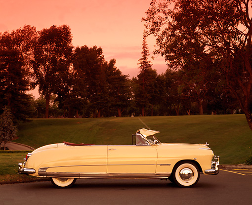 AUT 21 RK0454 02 © Kimball Stock 1950 Hudson Commodore Convertible Yellow Profile View On Pavement