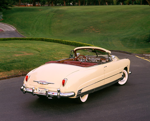 AUT 21 RK0455 01 © Kimball Stock 1950 Hudson Commodore Convertible Yellow 3/4 Rear View On Pavement By Mountains