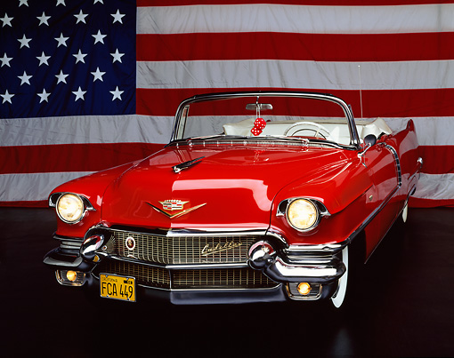 AUT 21 RK0474 03 © Kimball Stock 1956 Cadillac Convertible Red 3/4 Front View Patriotic Studio