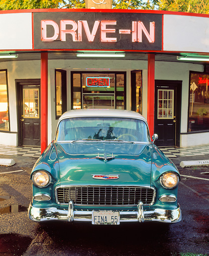 AUT 21 RK0485 02 © Kimball Stock 1955 Green And Ivory Chevy Bel Air Head On View On Wet Pavement In Front Of Diner Headlights On