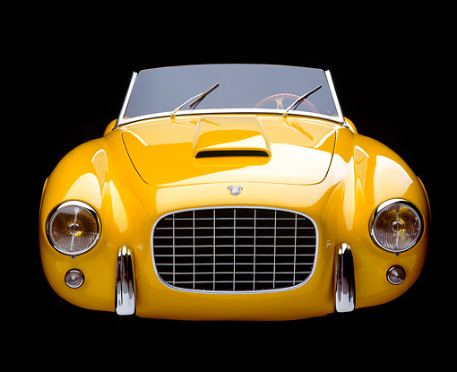 AUT 21 RK0500 02 © Kimball Stock 1952 Yellow Siata Spyder 208-S, head on in studio on black