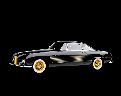AUT 21 RK0503 03 © Kimball Stock 1953 Black Cadillac Ghia Coupe, slight 3/4 front in studio on black