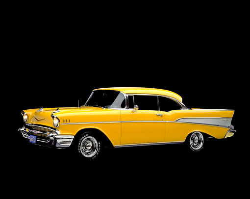 AUT 21 RK0517 07 © Kimball Stock 1957 Yellow Chevy Bel Air, slight 3/4 front in studio on black