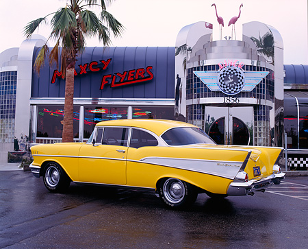 AUT 21 RK0539 13 © Kimball Stock 1957 Chevrolet Bel Air Yellow 3/4 Rear View By Diner