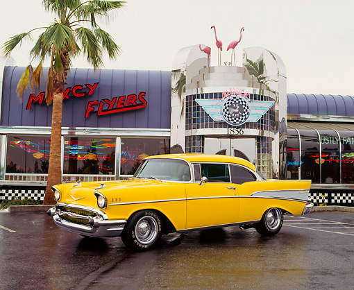 AUT 21 RK0540 02 © Kimball Stock 1957 Yellow Chevy Bel Air 3/4 Front View On Pavement By Diner