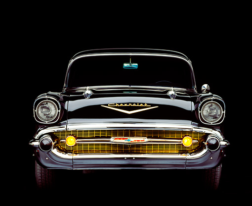 AUT 21 RK0568 05 © Kimball Stock 1957 Chevy Bel Air Black Head On Shot Parking Lights On Studio