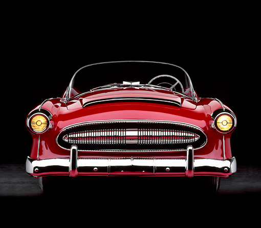 AUT 21 RK0575 01 © Kimball Stock 1953 Plymouth Belmont Convertible Red Head On View Headlights On Studio