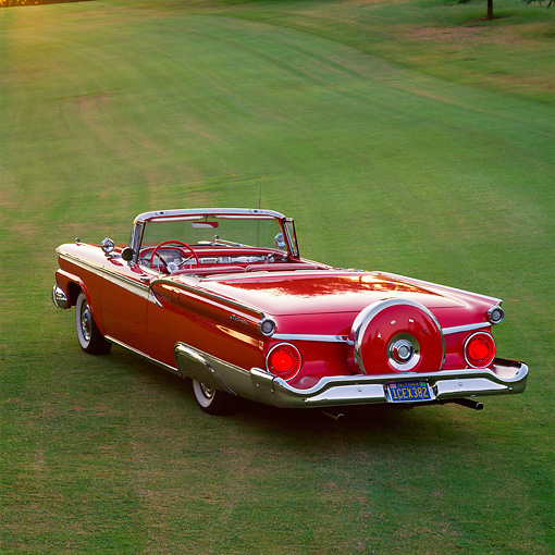 AUT 21 RK0588 01 © Kimball Stock 1959 Ford Fairlane Retractable Red Overhead 3/4 Rear View On Grass Brake Lights On At Dusk
