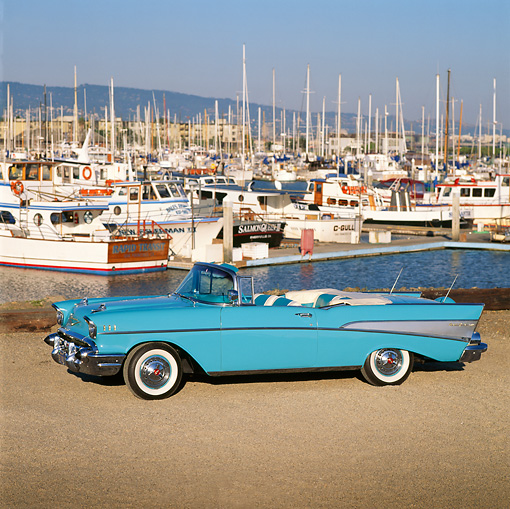 AUT 21 RK0608 06 © Kimball Stock 1957 Chevrolet Bel Air Convertible Light Blue 3/4 Front View On Gravel By Marina Blue Sky