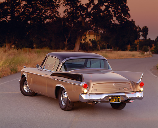 AUT 21 RK0657 05 © Kimball Stock 1958 Studebaker Golden Hawk 3/4 Rear View On Pavement Trees Filtered