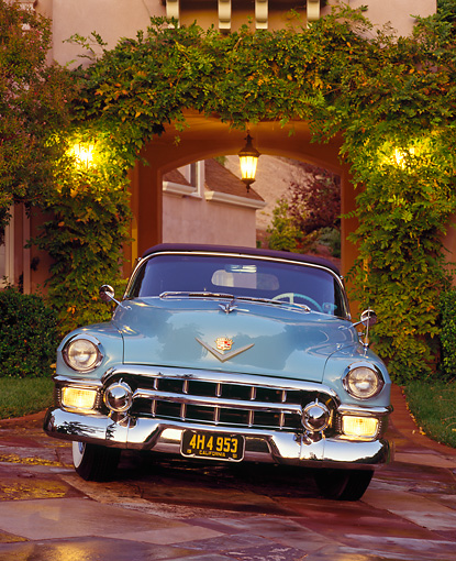 AUT 21 RK0687 04 © Kimball Stock 1953 Cadillac El Dorado Light Blue Head On Shot On Driveway Parking Lights On In Front Of House