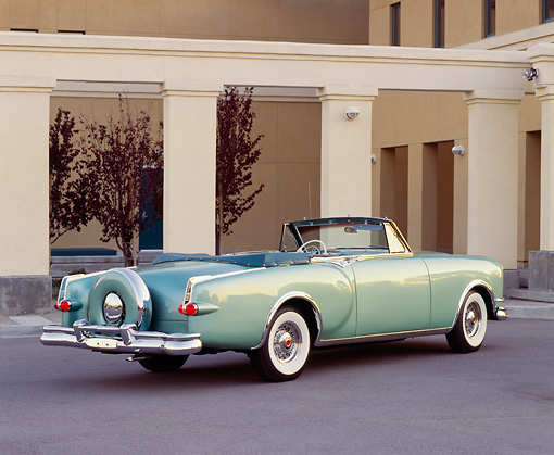 AUT 21 RK0722 08 © Kimball Stock 1953 Packard Caribbean Convertible Green 3/4 Rear View On Pavement By Pillars