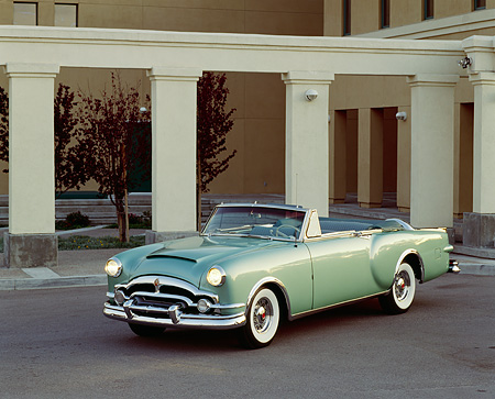 AUT 21 RK0724 02 © Kimball Stock 1953 Packard Caribbean Green Convertible 3/4 Front View On Pavement By Pillars