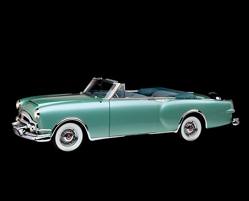 AUT 21 RK0725 02 © Kimball Stock 1953 Packard Caribbean Green Convertible 3/4 Front View Studio
